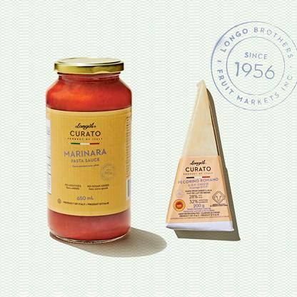 Longo's Curato products shot overhead, including pecorinno romano cheese and marinara pasta sauce.