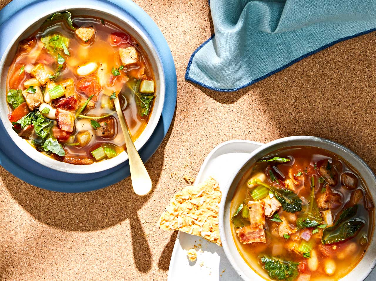 Tuscan Fall Soup in white bowls on a tabletop